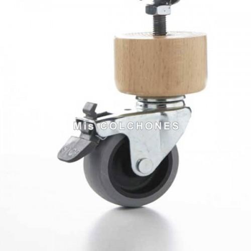 Pata cilíndrica de madera con rueda.
